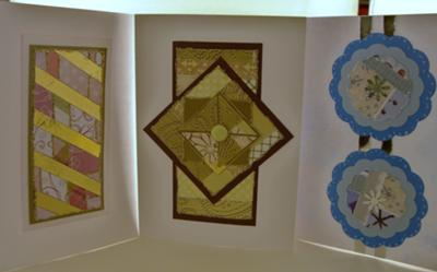 Three cards  are made from  scraps.